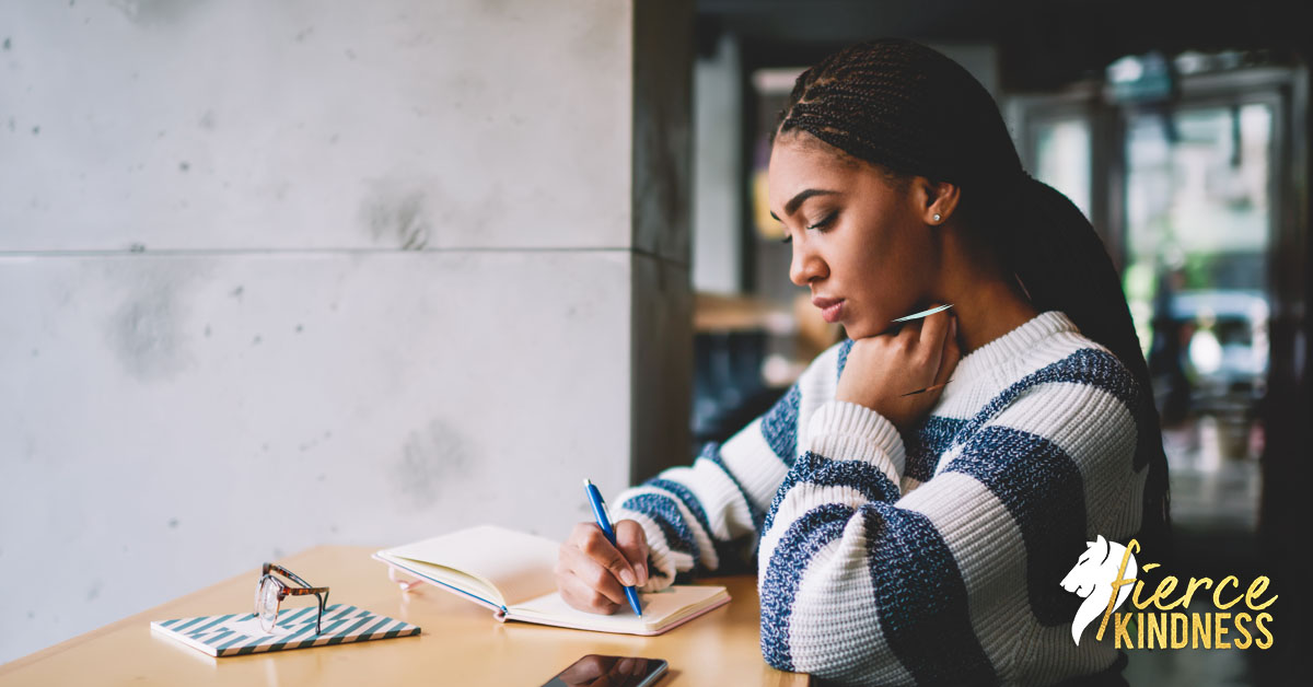 Woman Grieving Her Losses in Journal