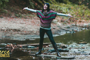 Gratitude Shown by Woman with Outstretched Arms