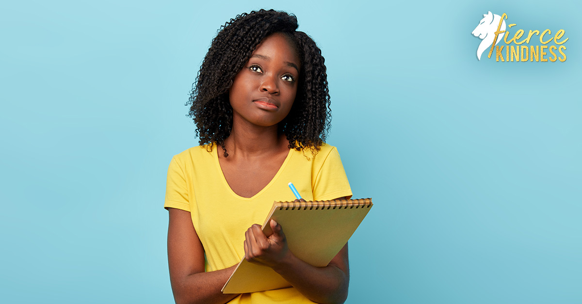 Young Woman Pondering Journaling Prompts for the New Year with Notebook