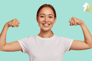 Woman feeling strong with fists pumped for Stockdale Paradox