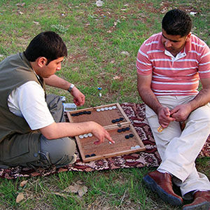 Two friends playing game outside