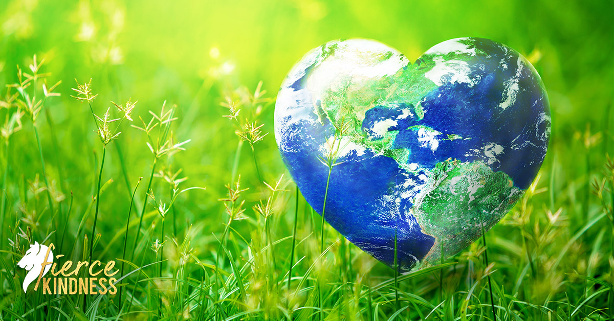Earth Day Planet as Heart Against Green Grass