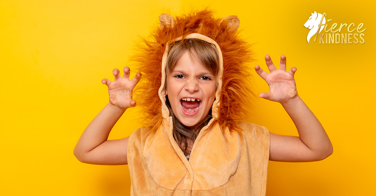 Girl pretending to be a lion