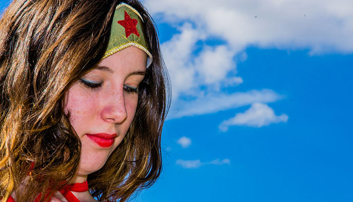 Girl dressed up as wonder woman confident